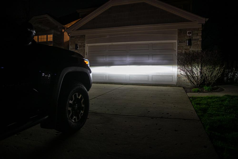 Garage Door Shot - Factory Tacoma LED Reflector Headlight Output