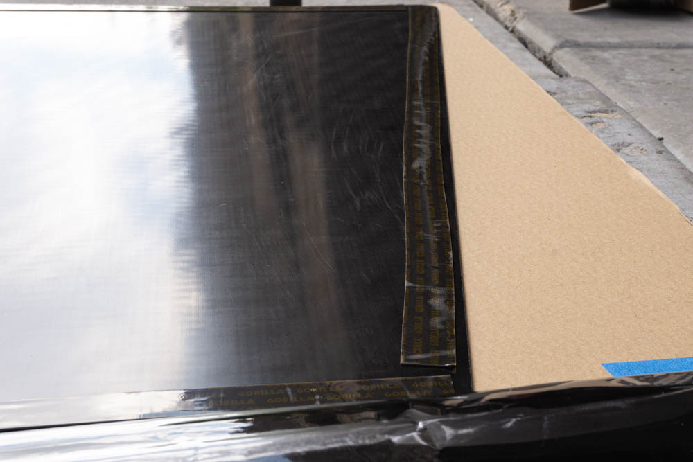 Double Sided Tape on Hood Mounted Solar Panel