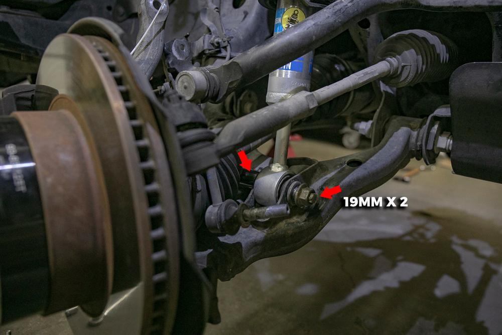 Remove 19mm Lower Shock Bolt