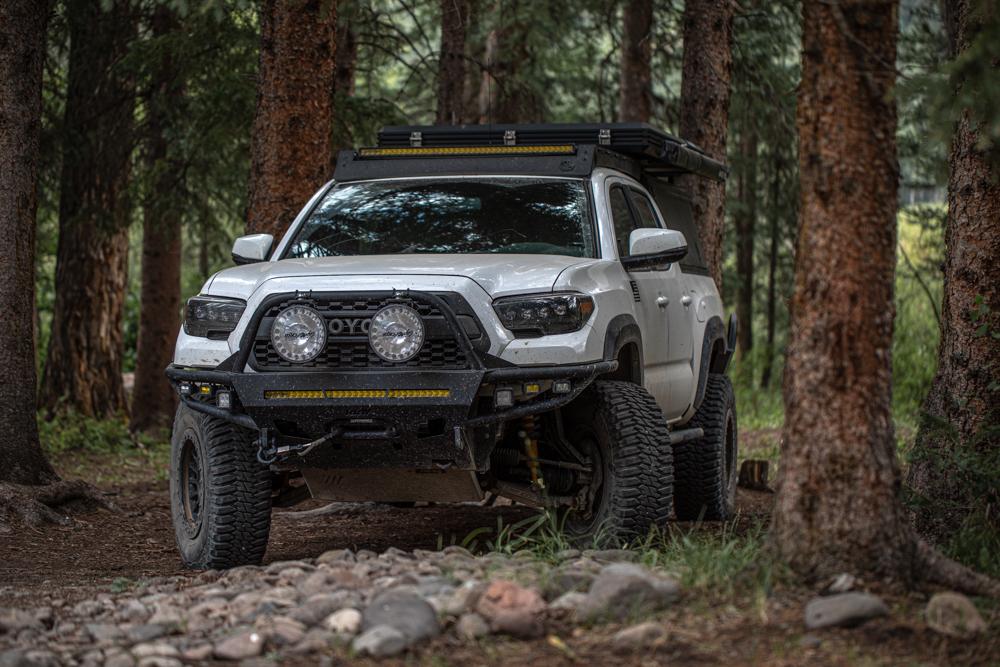 Lifted Super White 3rd Gen Tacoma with Blacked Out AlphaRex NOVA LED Headlights, Lightforce LED Lights & RRW Hybrid Front Bumper